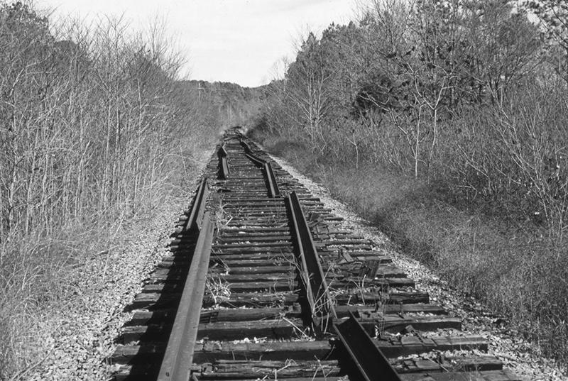 In March 1986 track that had been part of the mainline through western Arkansas had been taken apart near Waveland as the rails were about to be sold for scrap.