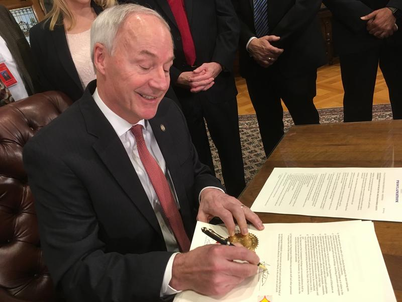 Asa Hutchinson signs an executive order Thursday creating the Arkansas School Safety Commission.