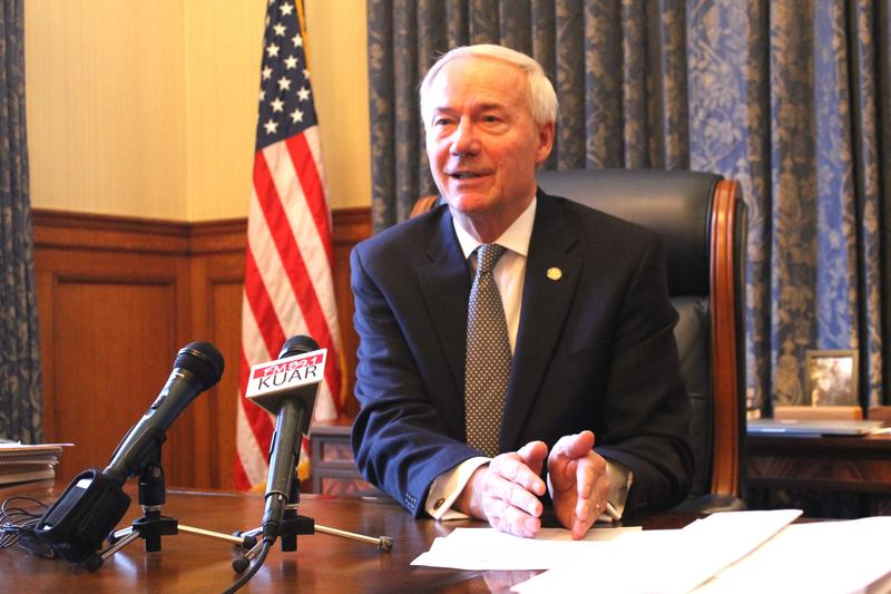 Gov. Asa Hutchinson speaking with reporters Monday in his office at the state Capitol.