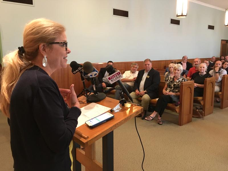 Rev. Betsy Singleton Snyder of First United Methodist Church calls for compassion for migrant families during Wednesday's press conference.