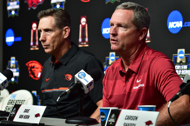 Oregon State baseball coach Pat Casey (left) and Arkansas coach Dave Van Horn at a press conference ahead of Monday's opening final in the College World Series.