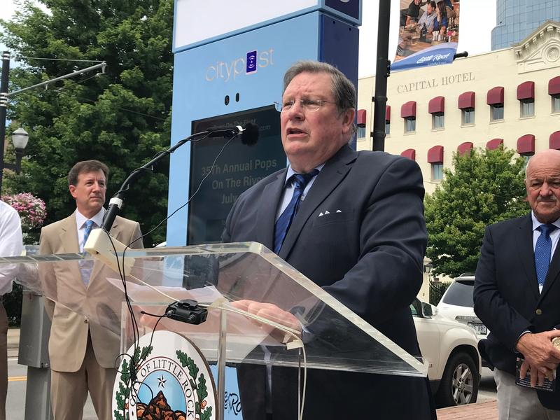 "Little Rock Mayor Mark Stodola unveils the city's first ""digital citizen engagement"" kiosk. It provides wifi service and allows people to learn about area events and businesses, get directions, and take selfies."