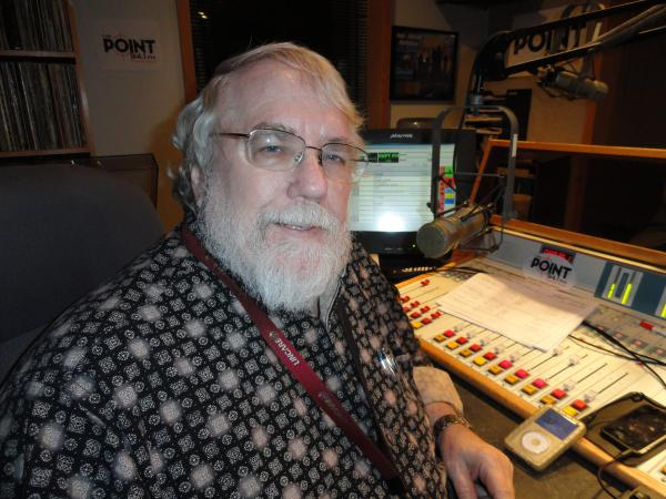 Clyde Clifford, whose real name is Dale Seidenschwarz, in the studio of KKPT-FM 94.1 The Point during his program Sunday.