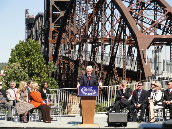 Former President Bill Clinton speaks at the dedication of the Clinton Presidential Park Bridge.