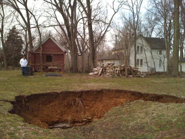 Karee Barrett near a large sinkhole at her farm in Benton County.