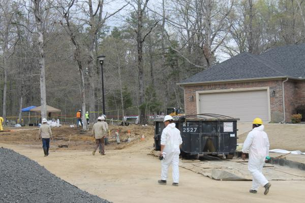 Workers on Sunday, April 7, working to clear the area around the pipeline so soil around it could be dug up.