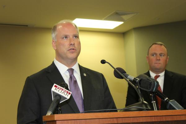 Arkansas Attorney General Dustin McDaniel and U.S. Attorney Christopher Thyer speaking to reporters Thursday at ADEQ headquarters in North Little Rock.