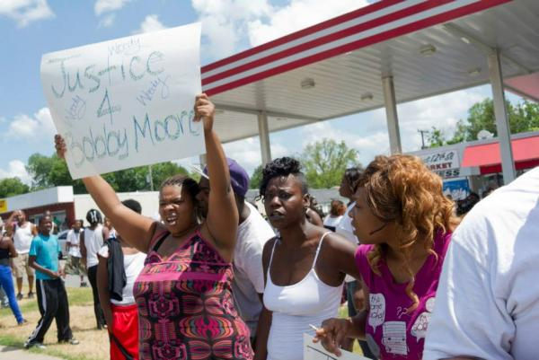 Demonstrators gathered across from the scene of Monday police shooting in Little Rock.
