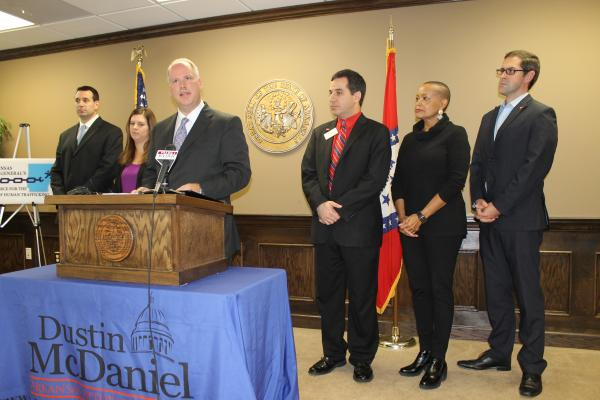 Attorney General Dustin McDaniel, alongside Arkansas legislators, announcing the creation Wednesday of a task force to investigate human trafficking.