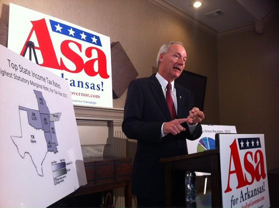 Asa Hutchinson speaking to reporters Tuesday in Little Rock.