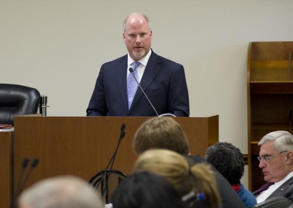 Attorney General Dustin McDaniel explains settlement proposal to a legislative committee.
