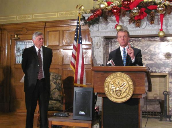 Governor Mike Beebe listens, as Conway Mayor Tab Townsell speaks during Wednesday's announcement.
