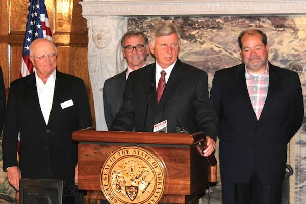 Gov. Mike Beebe at Tuesday's Ben E. Keith announcement. Company President Mike Roach is at far left, and company General Manager Rusty Mathis is at far right.