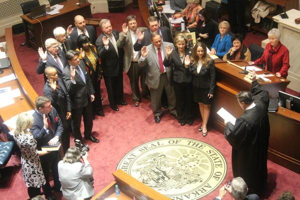 Arkansas State Supreme Court Justice Jim Hannah swears in Senators.