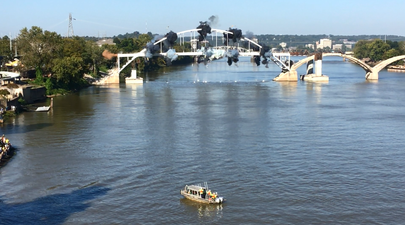 Crews pull down old Arkansas bridge after implosion fails