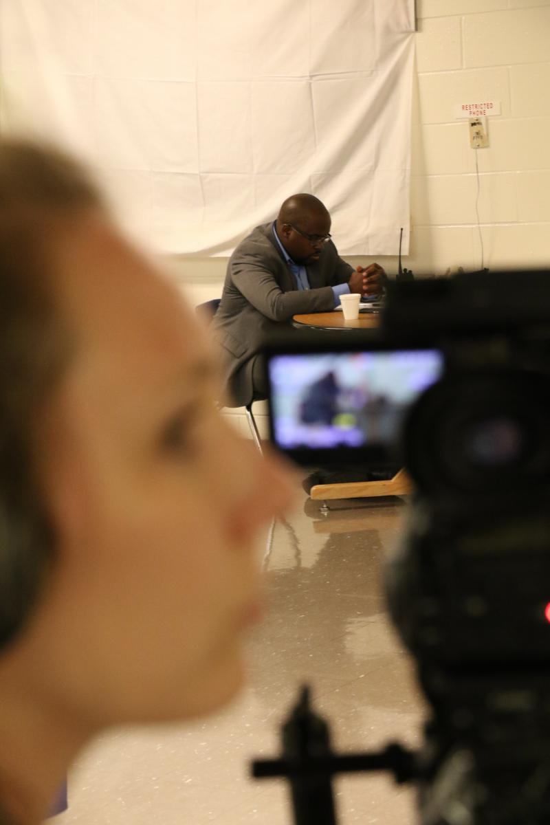 Corrections Department Spokesperson Solomon Graves takes a quick break during Thursday night's proceedings