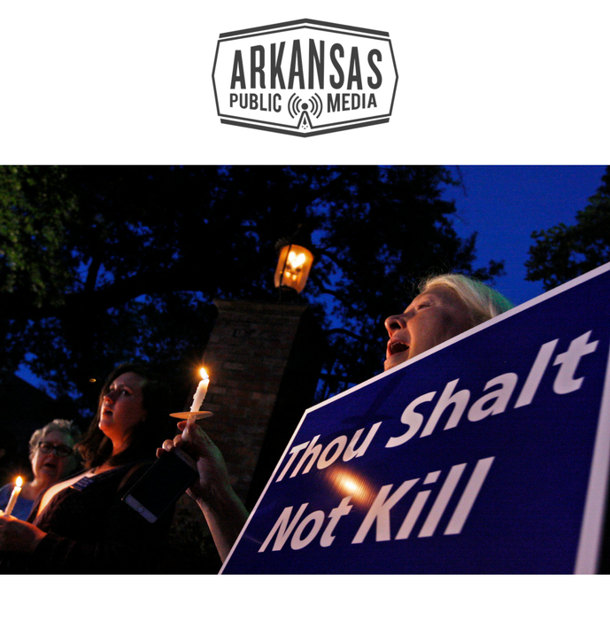 Death penalty opponents and members of the Arkansas Coalition to Abolish the Death Penalty didn't put down their signs, their candles or their smart phones even to sing Amazing Grace.