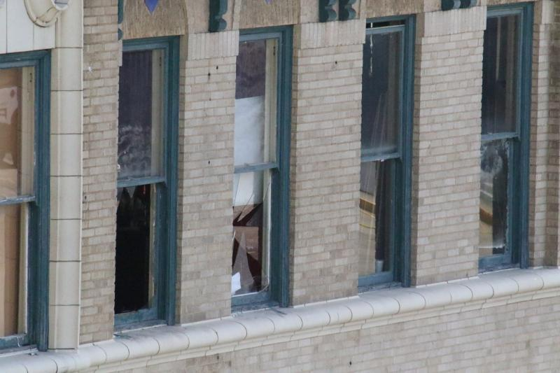 Patrons reportedly broke windows and leaped from the second story of the club to the sidewalk below to flee the gunfire.