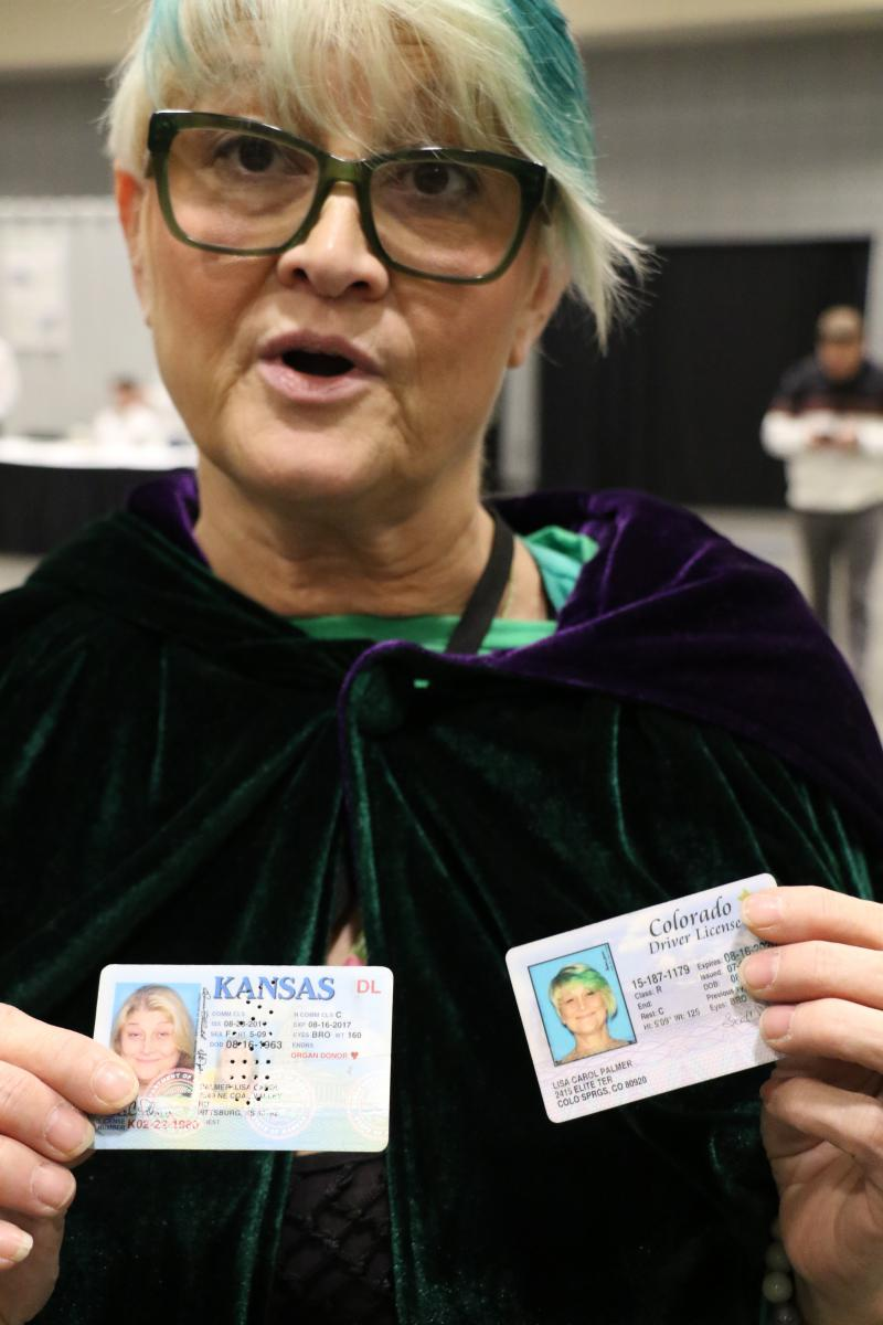 Lisa High, the Green Life Granny, holds up her old drivers license and her new one. Between then and now she quit prescription pain pills and took up cannabis treatments, as demonstrated, she says, in the difference between the photos.