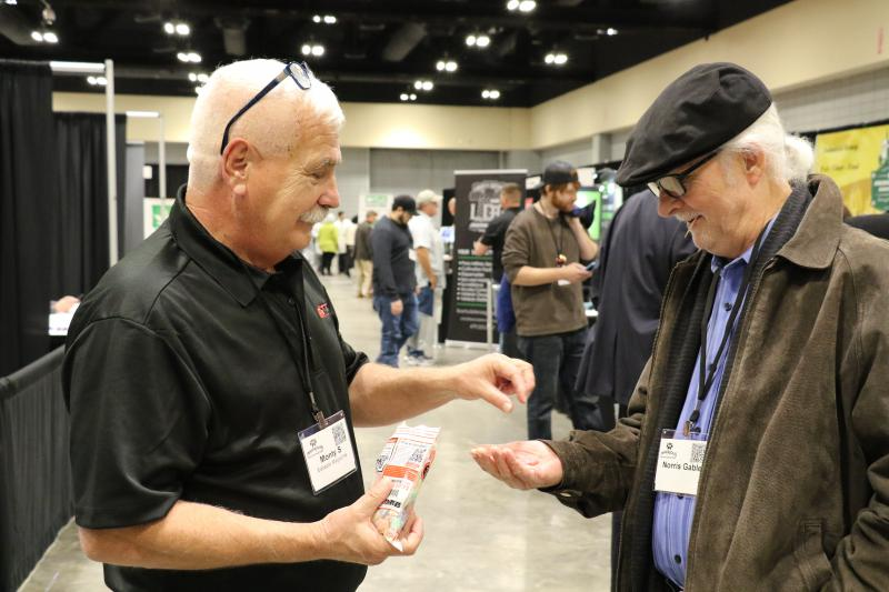 Morty Sowersby hands out CBD (cannabidiol) gummies to Morris Gable of Alabama.