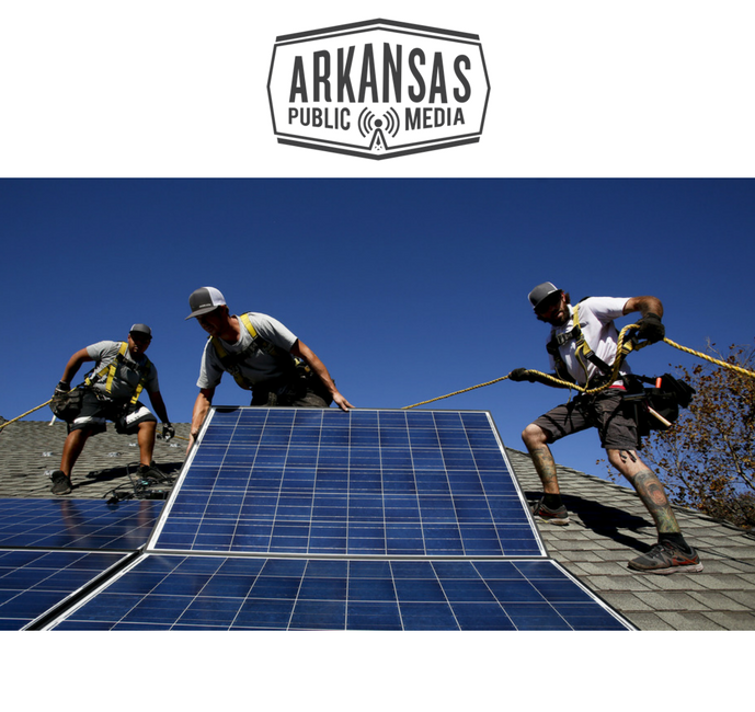 Workers install solar panels on a California roof. Private solar energy production has soared in recent years, and utilities in Arkansas say the retail rate credits they're able to produce get lowered.