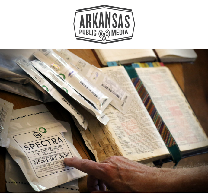 Medical cannabis products from Illinois are stacked beside Eureka Springs resident Jack Cross' well-thumbed Bible.