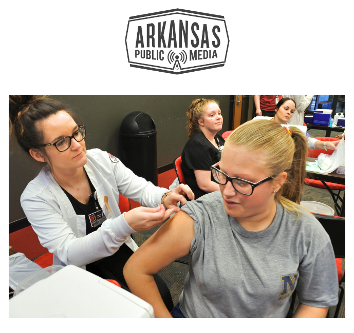 A-State student Cadence Rutherford gets a flu shot at a mass clinic offered at the Red Wolf Center on Oct. 2, 2018