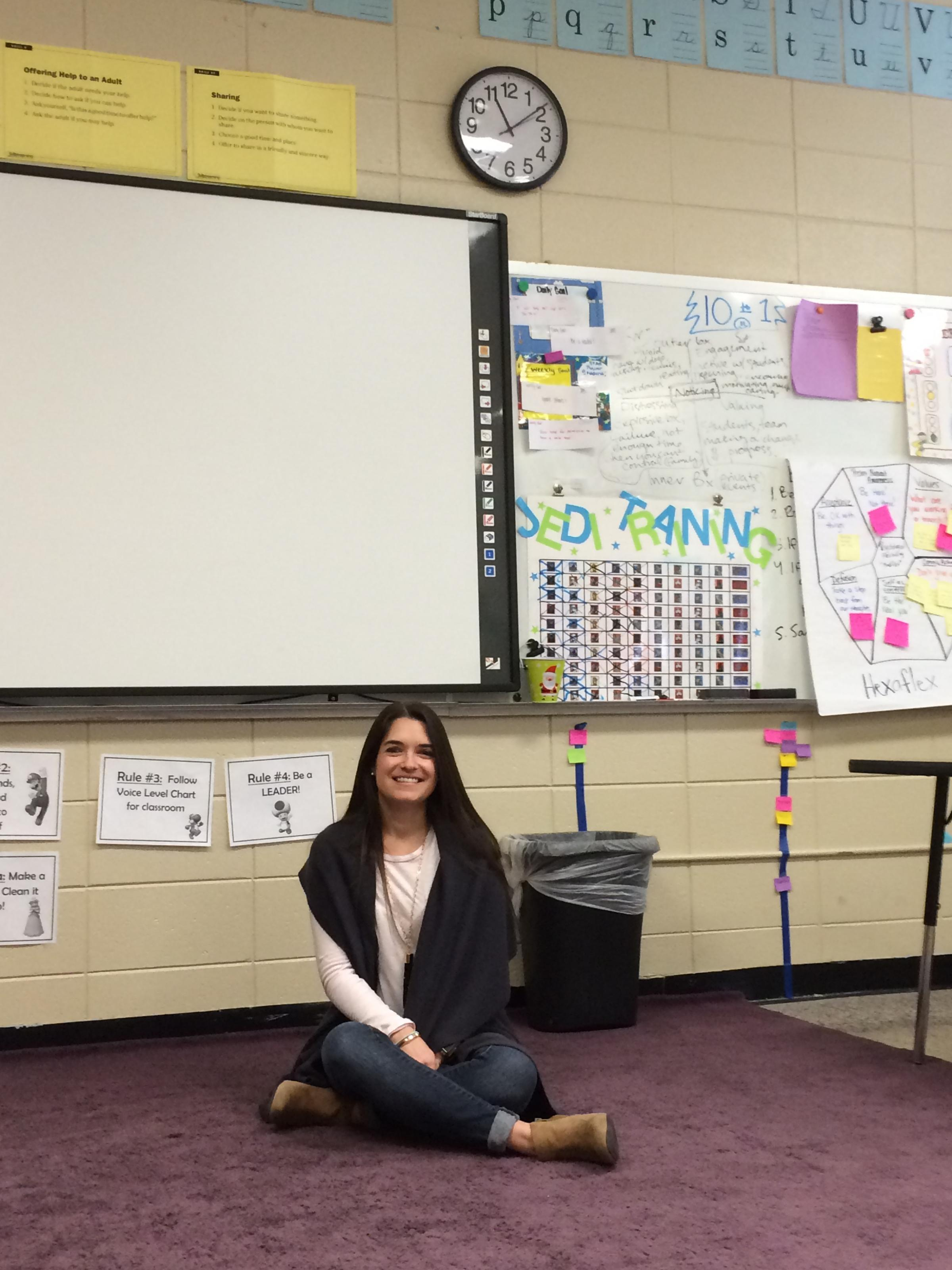 Bentonville School District behavioral specialist, Lindsey Lovelady sits on  a purple rug in the behavior classroom where children share story time.