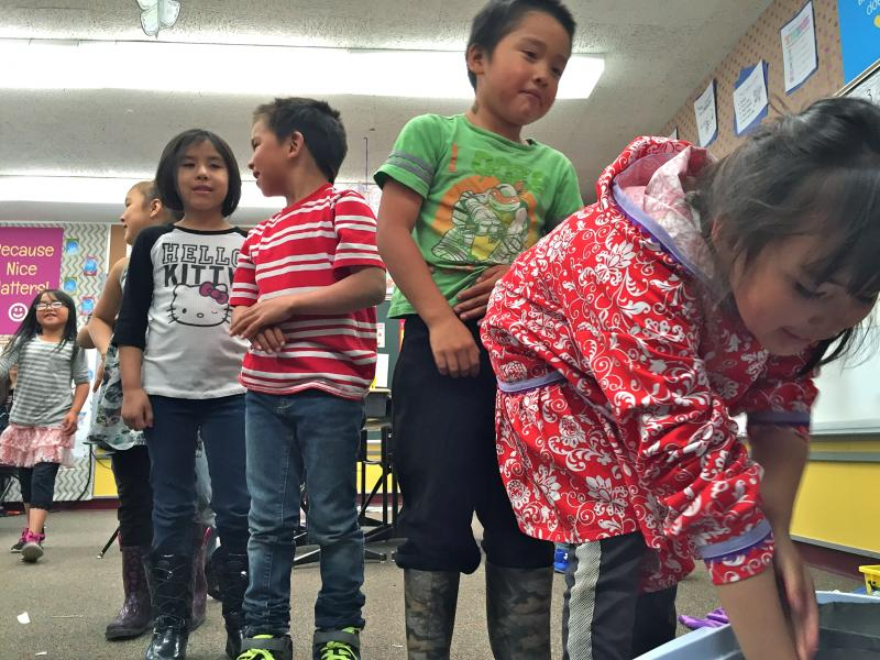 "St. Paul students line up to stick their hands inside ""blubber mitts"" (Crisco-lined plastic bags) to learn how marine mammals stay warm in the icy Bering Sea."