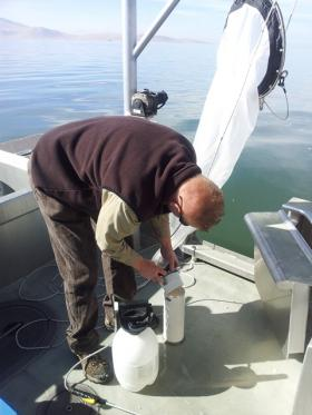 GSL Ecosystem Manager John Luft rinses out the net to make sure every microscopic organism is measured.
