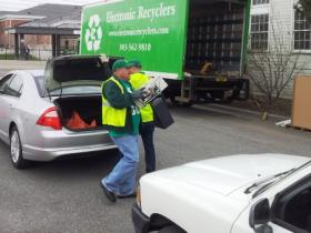 Workers with Electronic Recyclers International Inc. unload computer components at the University of Utah drop-off location.