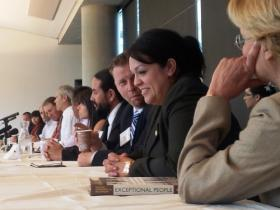 Democratic Senator Luz Robles and Republican Senator Todd Weiler (foreground) chat quietly during press conference following Immigration Reform Roundtable with a wide scope of community leaders.