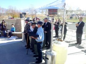 As Congressman Jim Matheson and other dignitaries applaud, four war heroes are presented with special flags in honor of their service. State Senator Karen Mayne, Utah House Rep. James Dunnigan and the current and mayor-elect of Taylorsville were among those on hand for the celebration.