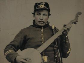 A Union soldier poses with a banjo.