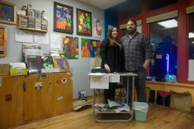 Alana and Adam Tye, owners of Diabolical Records, stand proudly in their store knowing they have created the career of their dreams.