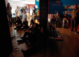 A crowd gets comfortable inside Diabolical Records while watching a set played by local act, Tavaputs.