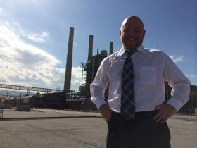 Rocky Mountain Power Spokesman Paul Murphy stands in front of the Gadsby plant in Salt Lake City. The plant used to be powered by coal, but in the 90's the company converted it to natural gas.