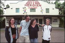 The Pierson Family in front of the 180 Meridian Cinema in Fiji.