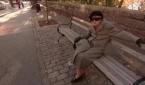 Essie Schiller, 94, rests on a park bench