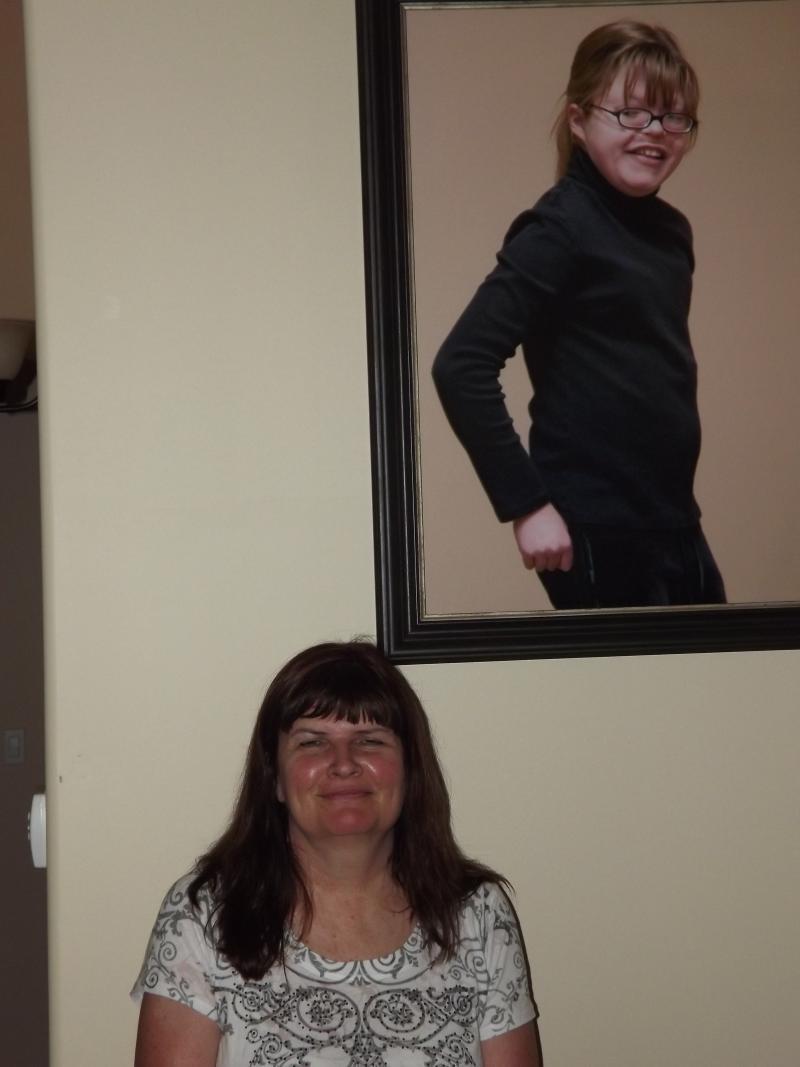 Bobbi Mathews with a photo of her daughter Katie