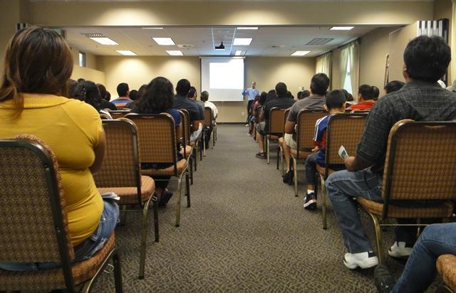 Attorney Mark Alvarez leads an information session on deferred action status at the Utah Cultural Celebration Center in West Valley City.