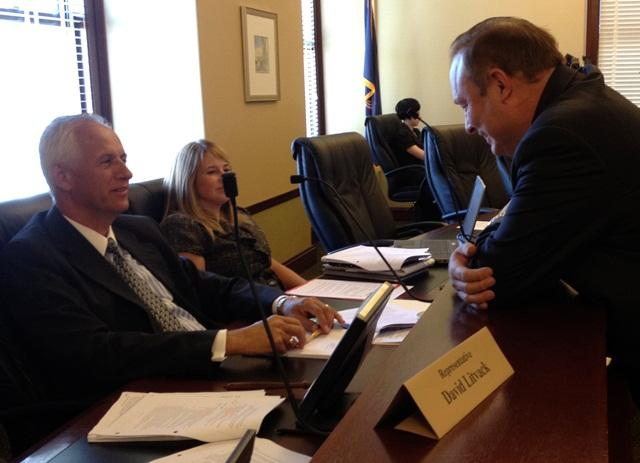 State Senate President Michael Waddoups and Utah Democratic Party Chair Jim Dabakis share a word during a recess of the Legislative Records Committee.