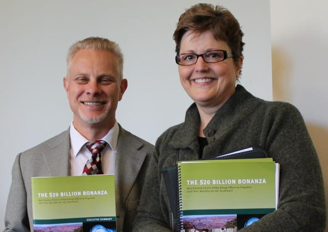 Director of the Southwest Energy Efficiency Project Howard Geller and Carol Hunter of Rocky Mountain Power hold copies of the SWEEP report.