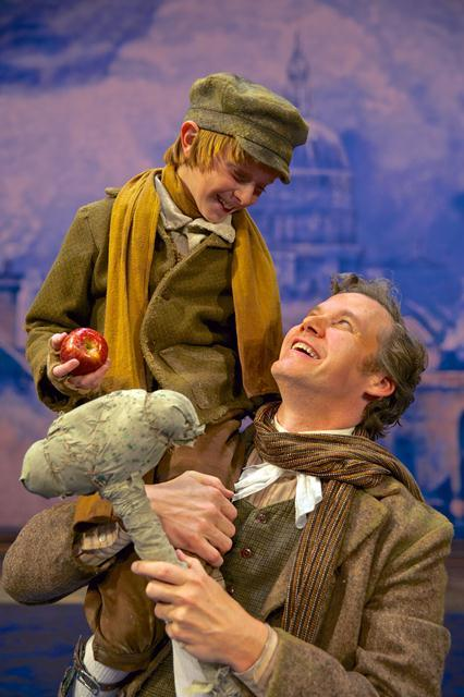 L-R: Anson Bagley (Tiny Tim) and Kevin Earley as his devoted father Bob Cratchit.