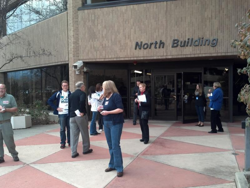 Campaigners greet delegates as they enter the Salt Lake County Building