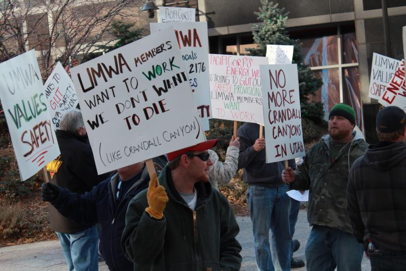 Members of UMWA local 1769 and 2176 picket at the Gallivan Center