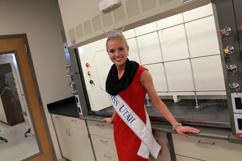 Miss Utah, Kara Arnold, poses in front of new science equipment in the Thatcher Building for Biological and Biophysical Chemistry on the University of Utah Campus