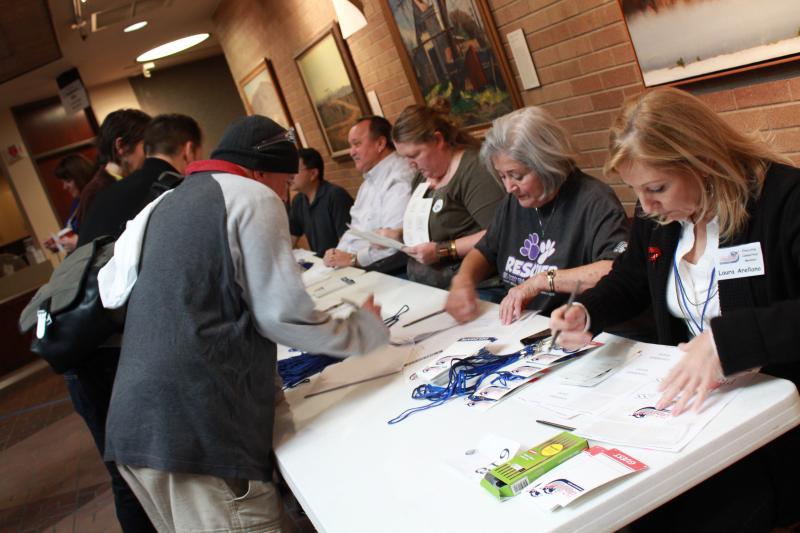 Delegates register before voting