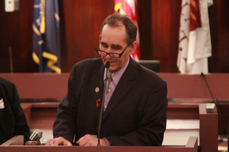 Robert Comstock speaks to delegates in the Salt Lake County Council chamber