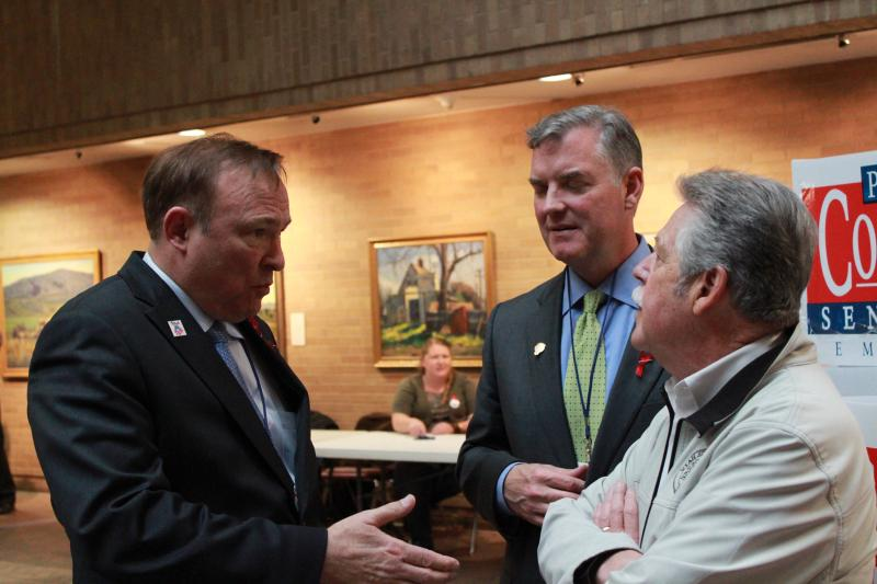 Jim Dabakis, Peter Coroon, and Senator Gene Davis meet together in the lobby as they wait for the votes to be counted.